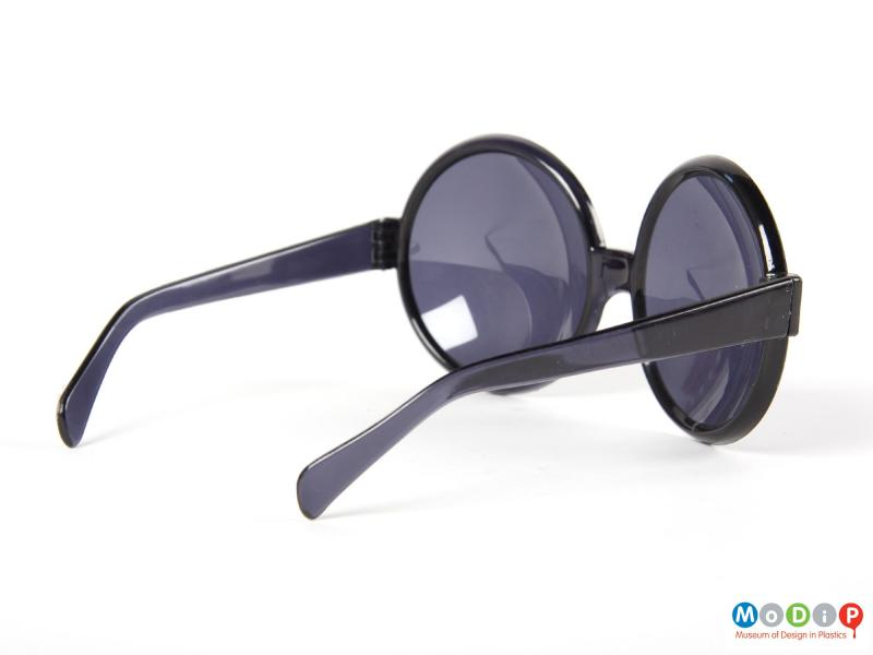 Side view of a pair of sunglasses showing the wide arm.