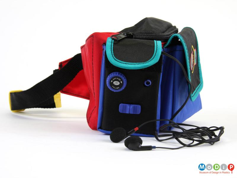 Side view of a radio bag showing the headphones.