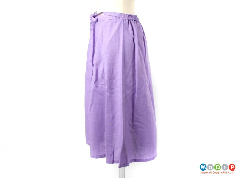 Side view of a skirt showing the straight hemline.