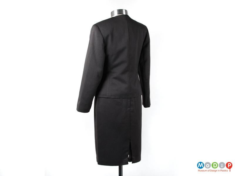 Rear view of a skirt suit showing the single vent in the skirt.