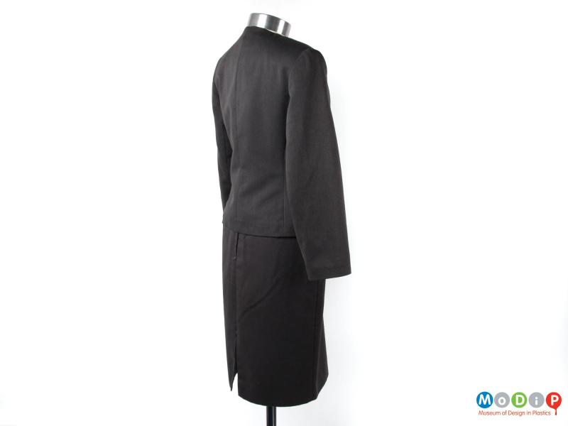 Side view of a skirt suit showing the long sleeves.