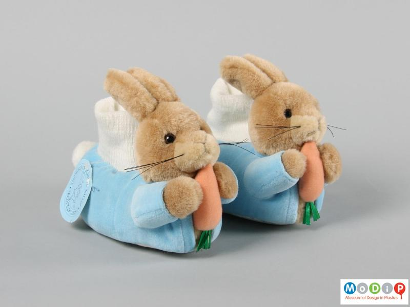 Front view of a pair of slipper showing the rabbit figures on the toe.