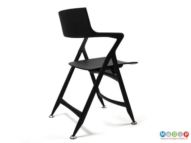 Side view of a Dolly Chair showing the angular shape of the arms.