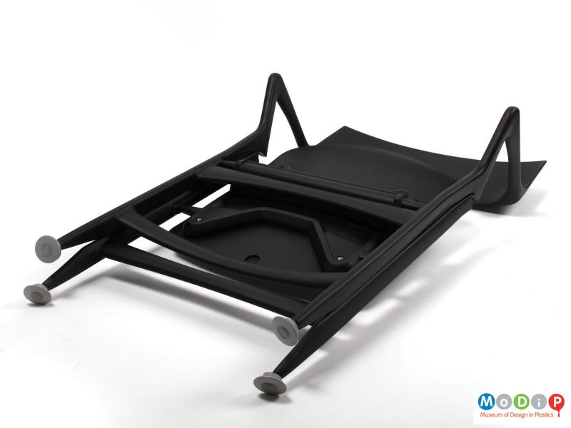 Underside view of a Dolly Chair showing the chair folded.