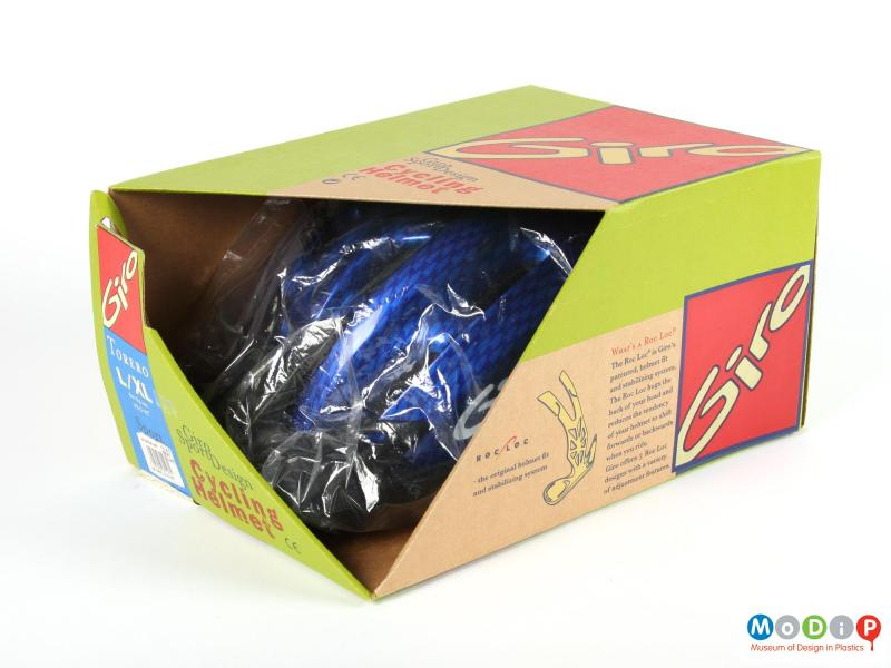 Side view of a Giro helmet showing in its original packaging.