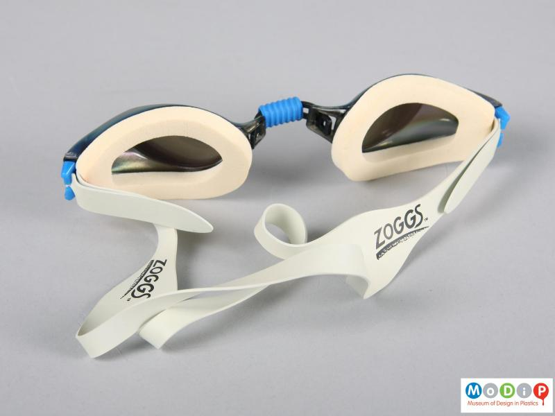 Rear view of a pair of swimming goggles showing foam eyepieces.