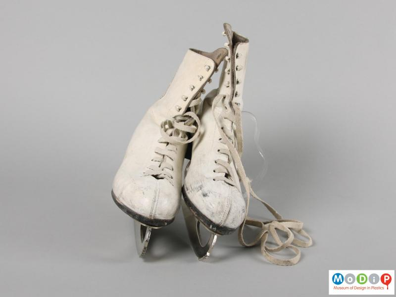 Front view of a pair of ice skates showing the laces.