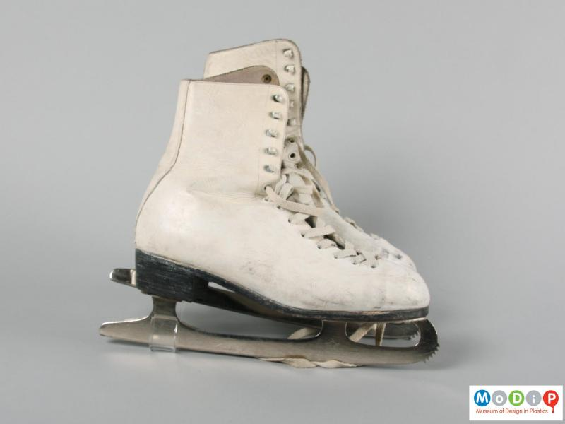 Side view of a pair of ice skates showing the blades.
