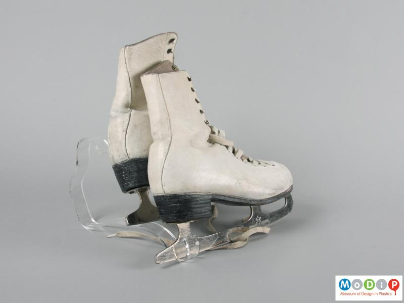 Rear view of a pair of ice skates showing the heels.