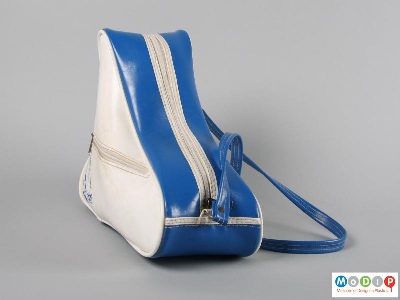 Front view of a pair of ice skates showing the carrying case.