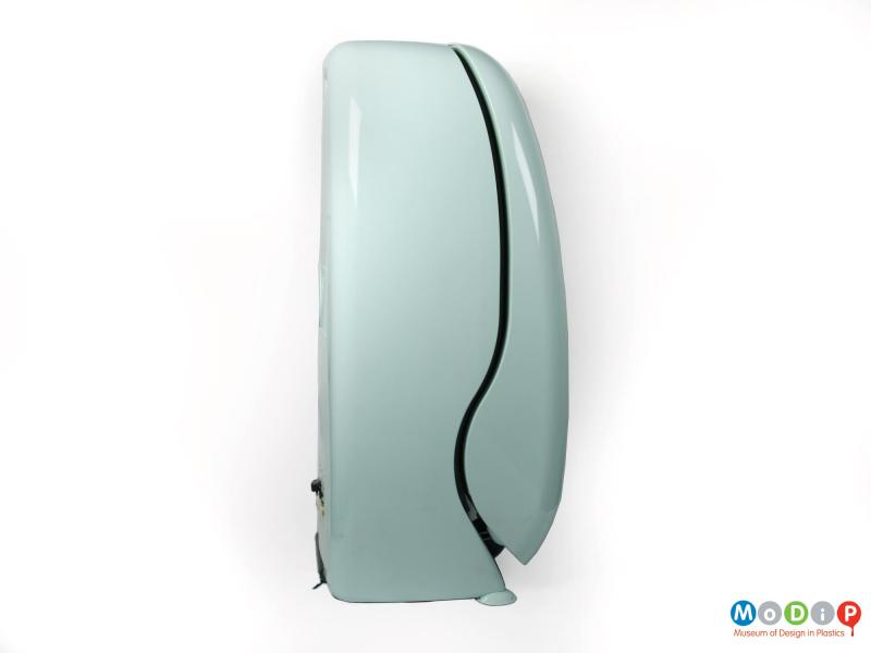 Side view of an Oz fridge showing the curve of the door and the rounded shape of the body.