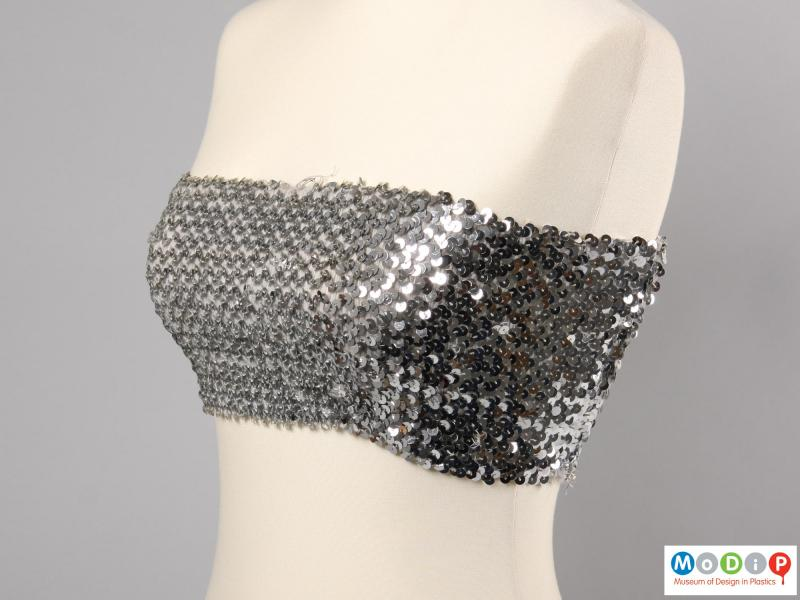 Side view of a boob tube showing the rows of sequins.