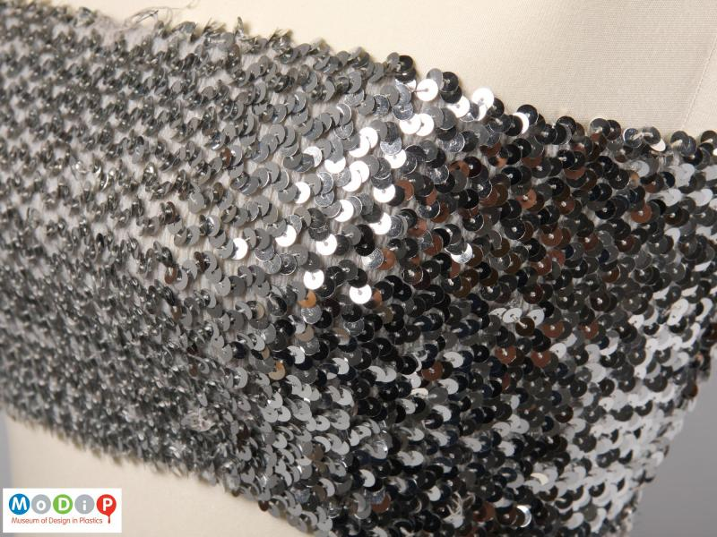 Close view of a boob tube showing how the sequins are attached.