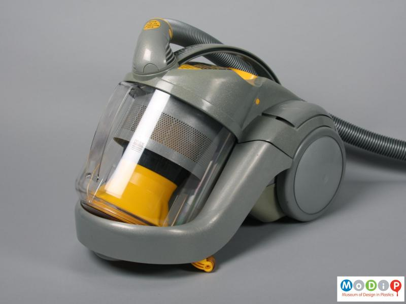 Front view of a vacuum cleaner showing the clear bin.