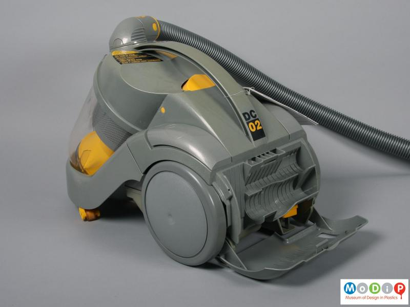 Rear view of a vacuum cleaner showing the open cover.