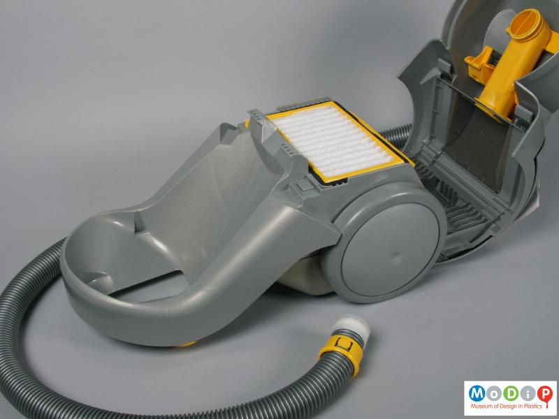 Side view of a vacuum cleaner showing the base unit.