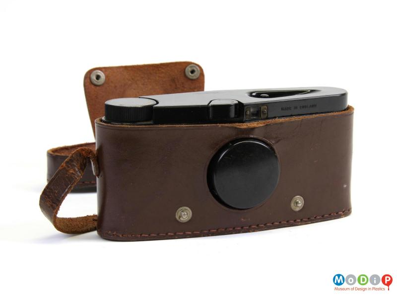 Front view of a camera showing the leather case.