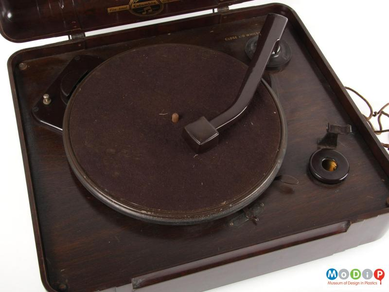 Close view of a record player showing the turntable.