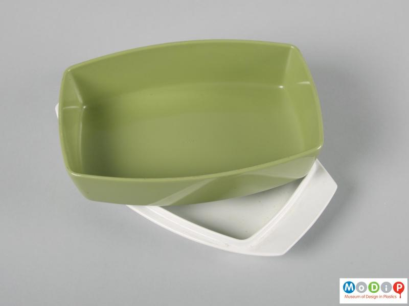 Top view of a butter dish showing the underside of the lid.