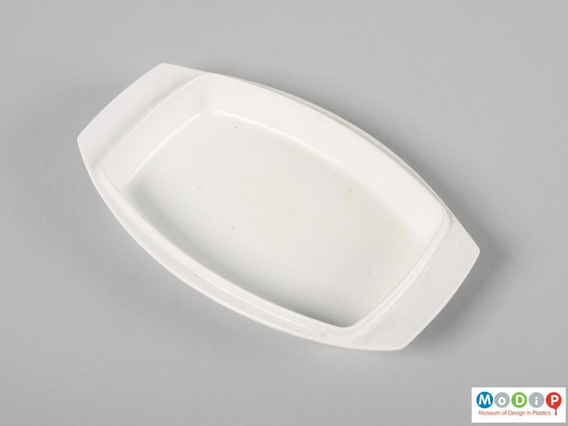Top view of a butter dish showing the inside surface of the base.