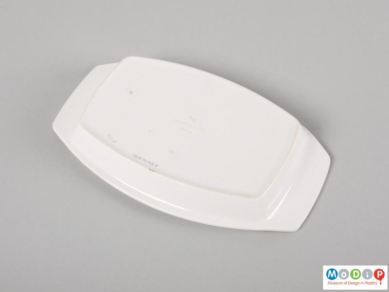 Underside view of a butter dish showing the base.