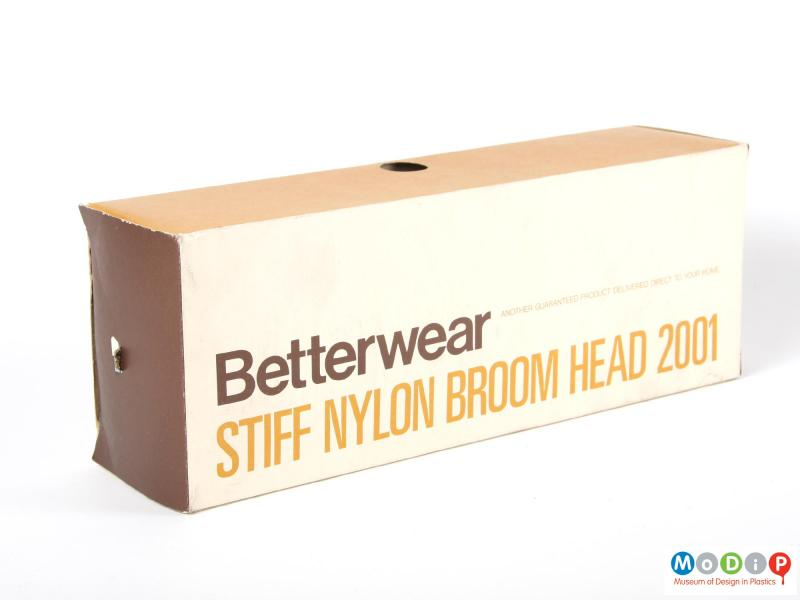 Side view of a broom head showing the original box.