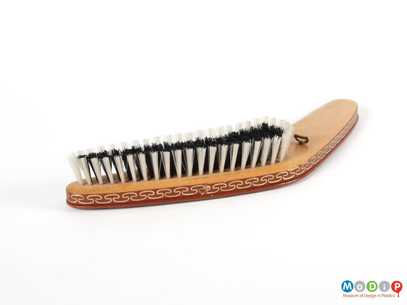 Side view of a clothes brush showing the bristles.