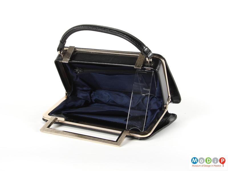 Inside view of a handbag showing the blue lining.