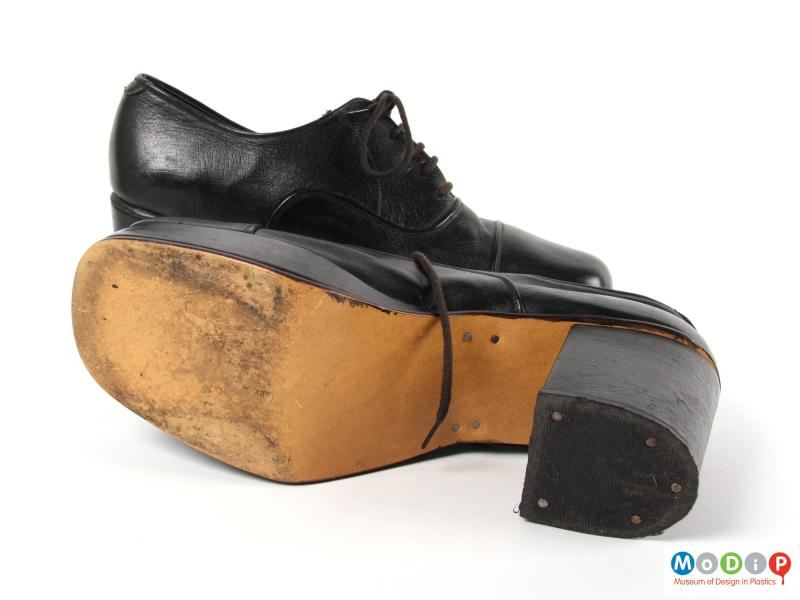 Underside view of a pair of shoes showing the soles.