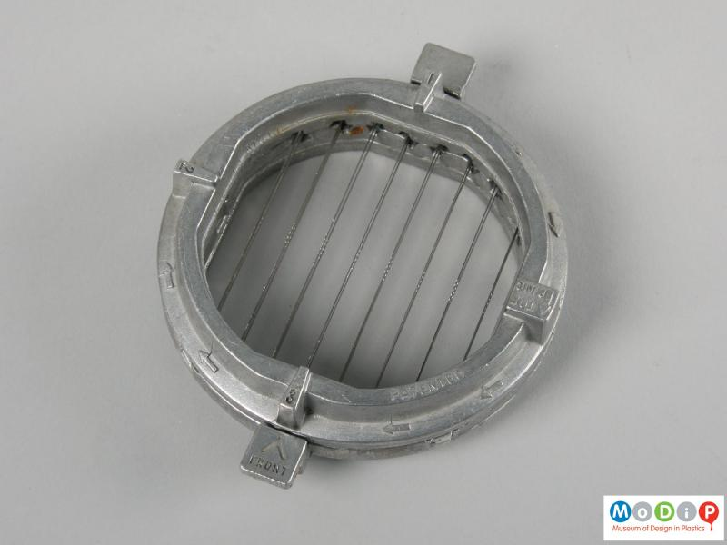 Top view of a food chopper showing the metal blades.