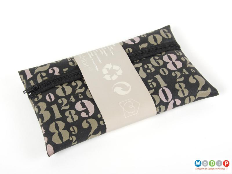 Front view of a Reco pencil case showing the pencil case in the cardboard sales sleeve.
