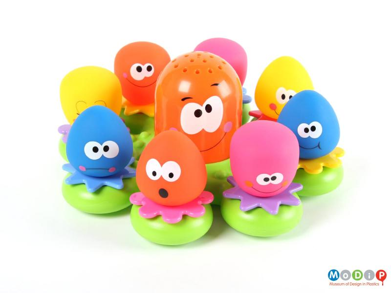 Front view of a bath toy showing all the figures sitting in place.