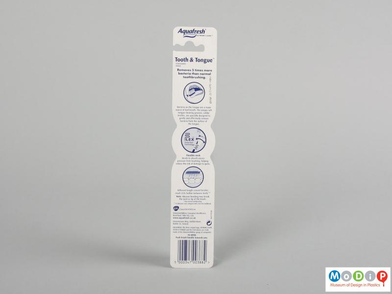 Rear view of a toothbrush showing the packaging.
