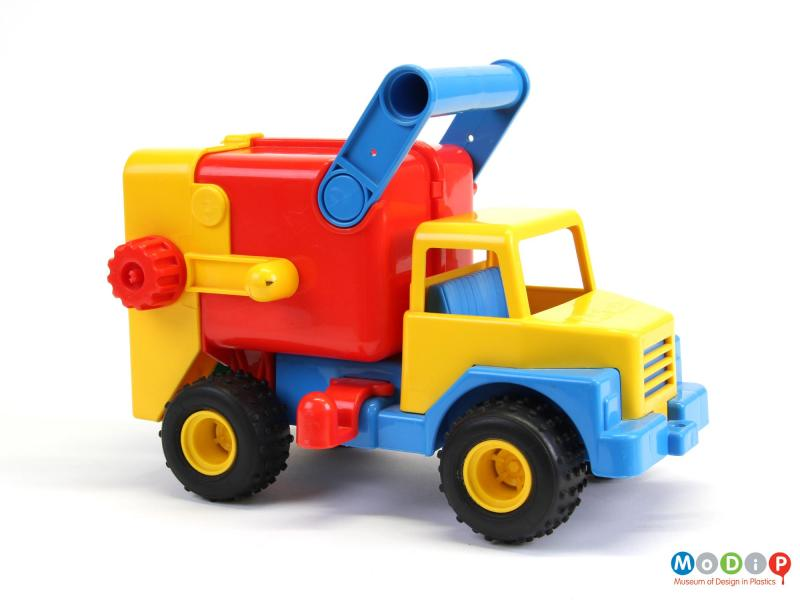 Side view of a toy truck showing the carry handle.