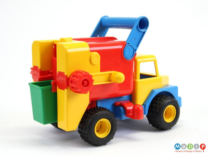 Rear view of a toy truck showing the bin at the back.