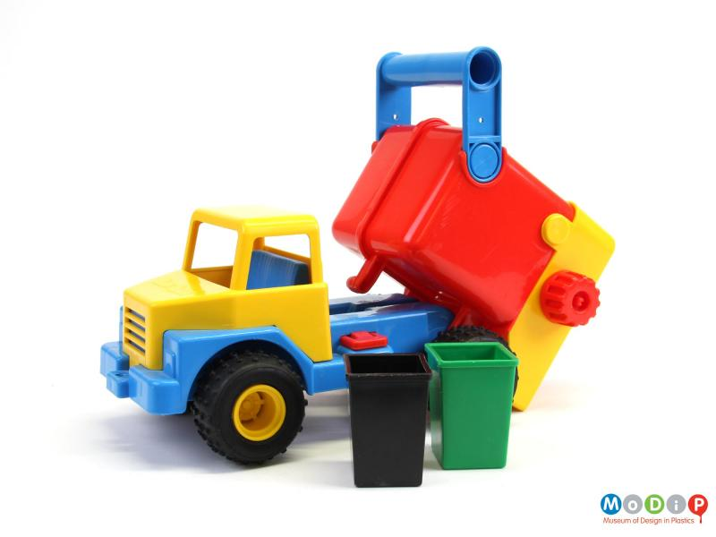 Side view of a toy truck showing the dumper action.