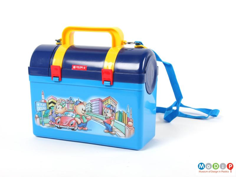 Side view of a Lion Star lunch box showing the flask and lunch box attached.