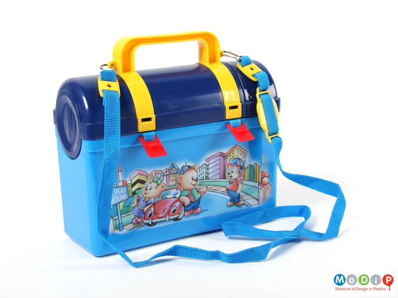 Side view of a Lion Star lunch box showing the flask and lunch box attached but with the clips undone.