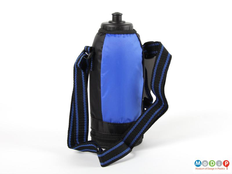 Rear view of a Thermos insulated bottle showing the plain back and the shoulder strap.