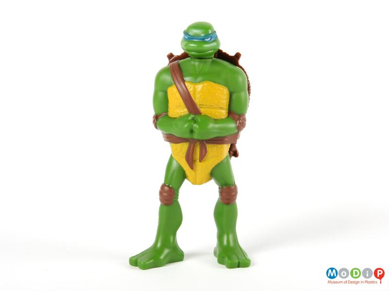 Front view of a Turtle figure showing the arms held at the front with clenched fists.