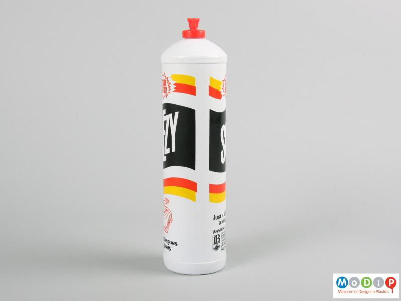 Side view of a Sqezy bottle showing the printed design.