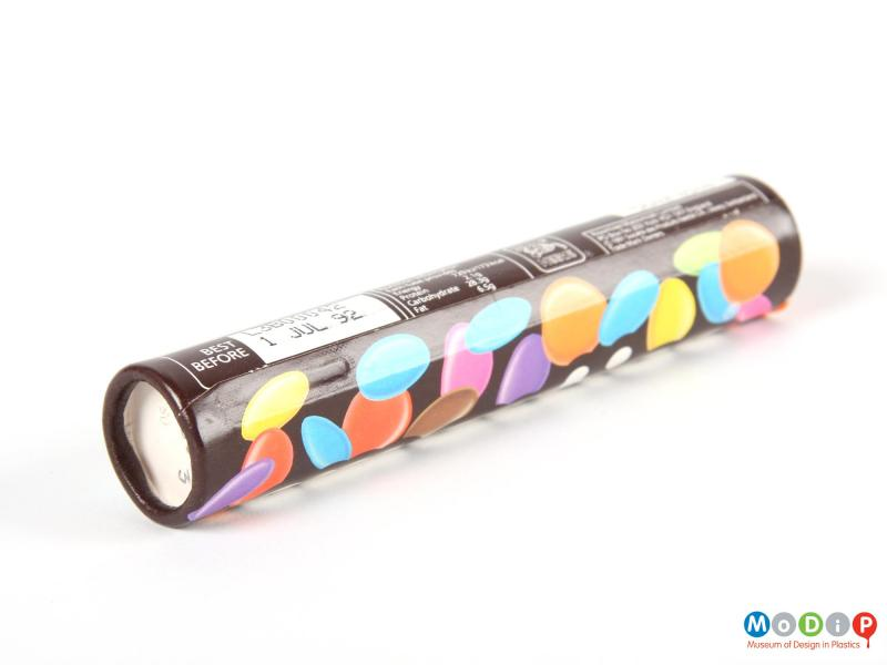 Underside view of a Smarties tube showing the base.