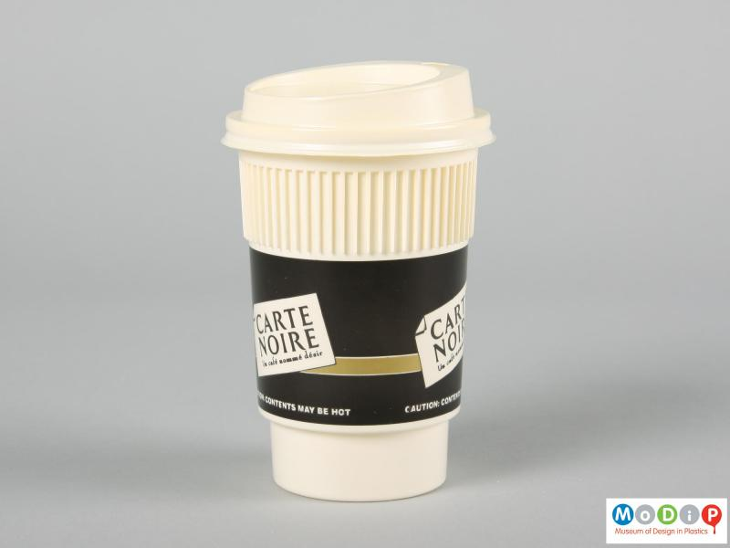 Side view of a disposable coffee cup showing the heat insulating ridges.
