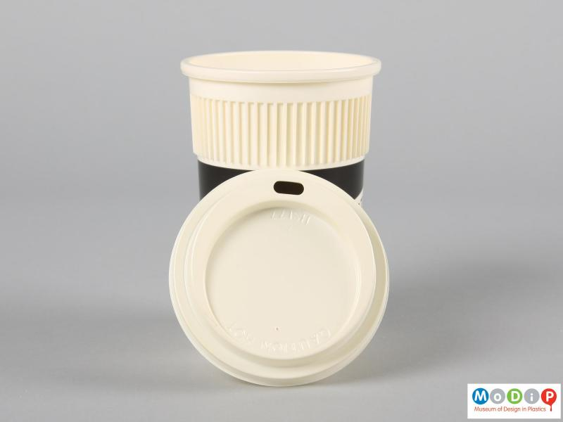 Top view of a disposable coffee cup showing the lid.