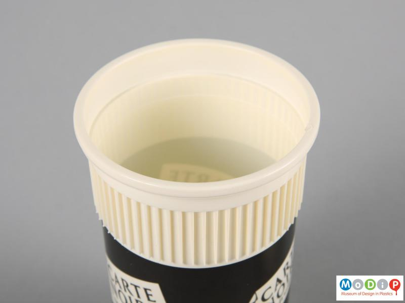 Top view of a disposable coffee cup showing the smooth internal surface.