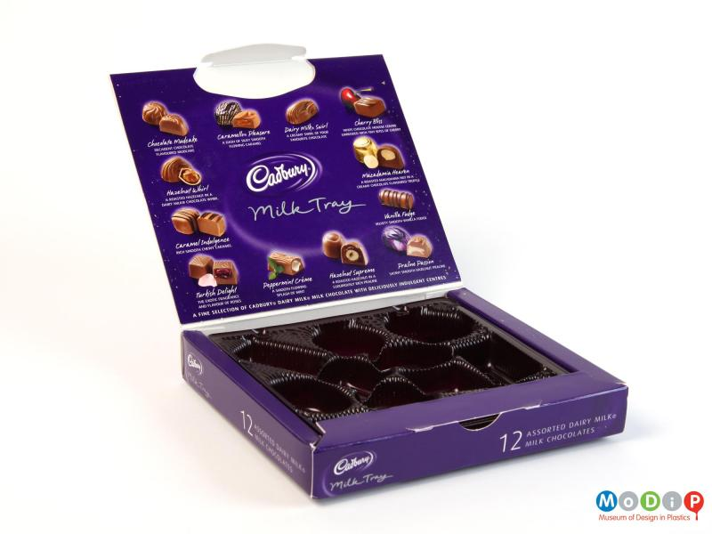 Side view of a chocolate box showing the moulded tray inside the box.