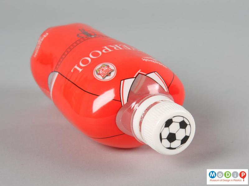 Top view of a football strip bottle showing the football design on the top of the cap.