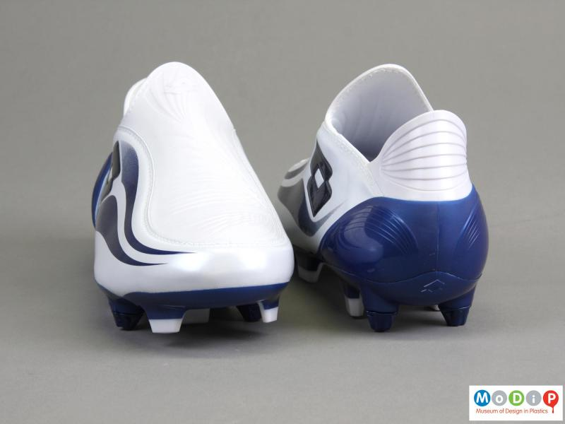 REar view of a pair of football boots showing the shape of the heel.