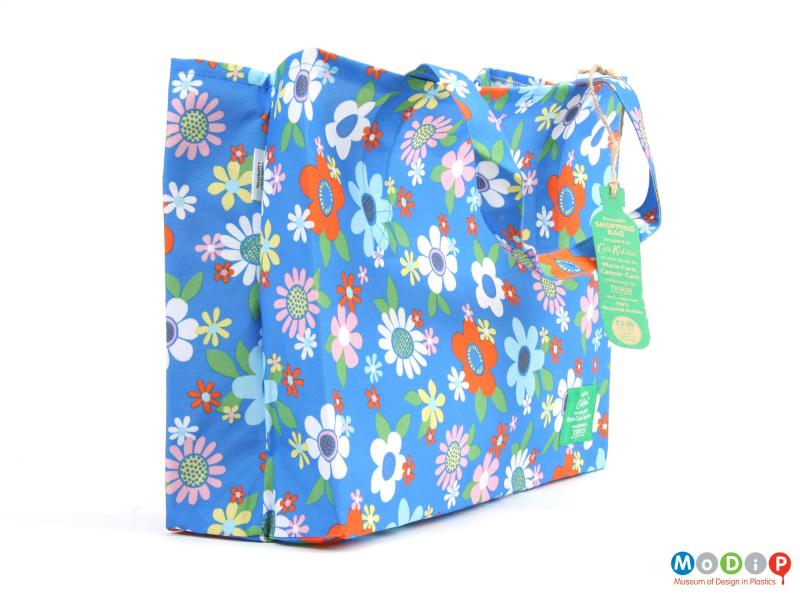Side view of a bag showing the floral print.