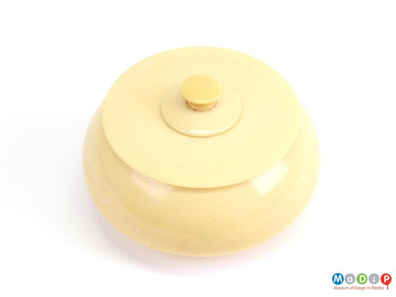Top view of a powder bowl showing the flat lid and finial.
